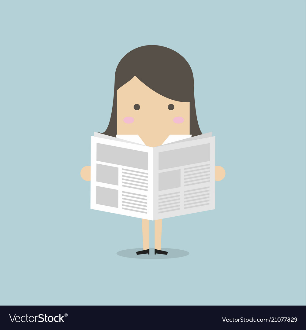 Businesswoman standing and reading a newspaper