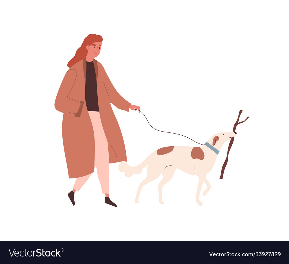 Woman in autumn coat walking with pet on leash