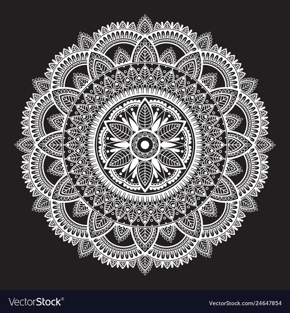 White round ethnic mandala on black background