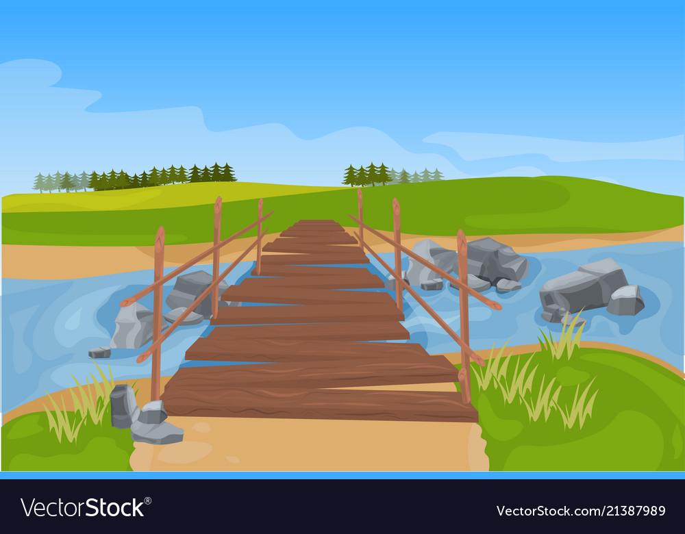 Wooden bridge across river mountain landscape
