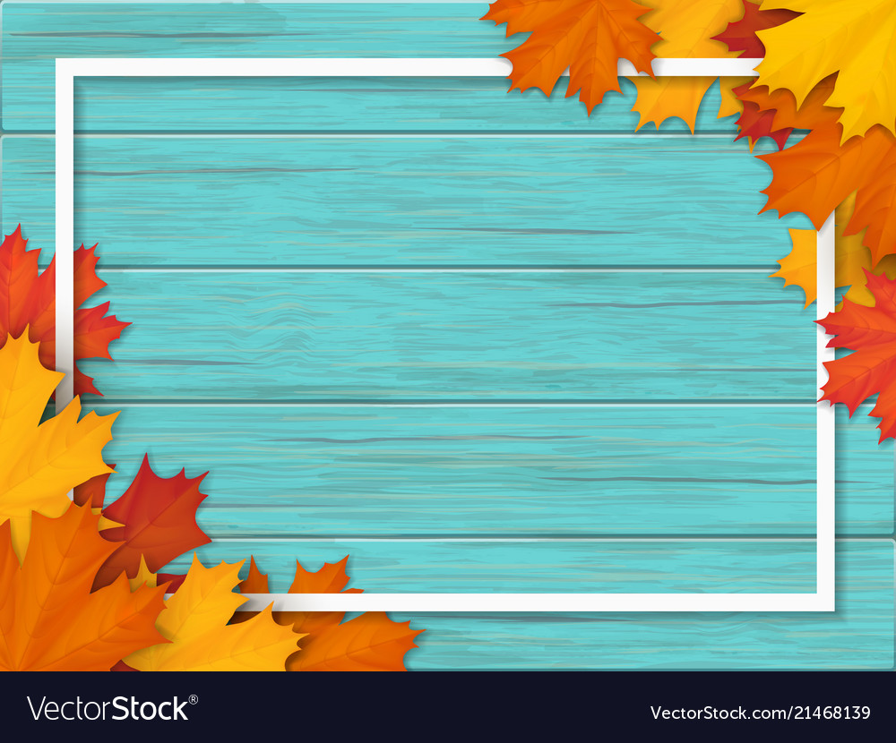 Autumn leaves and frame on old wooden background
