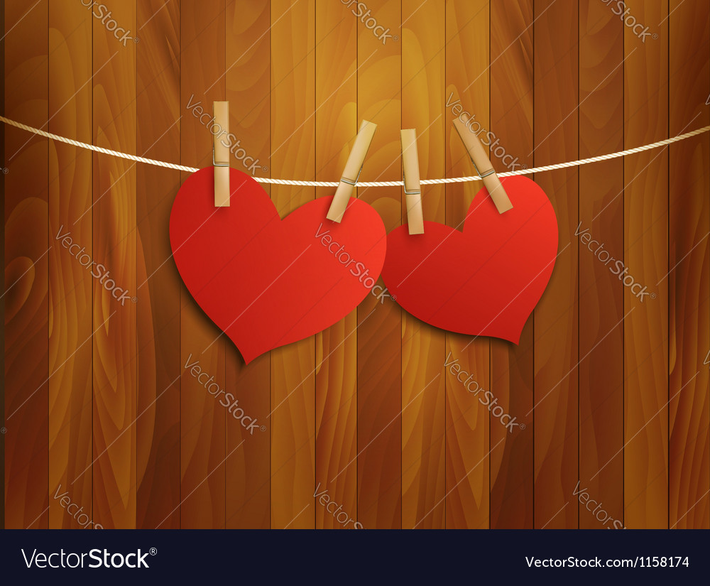 Two red loving hearts hanging on a rope