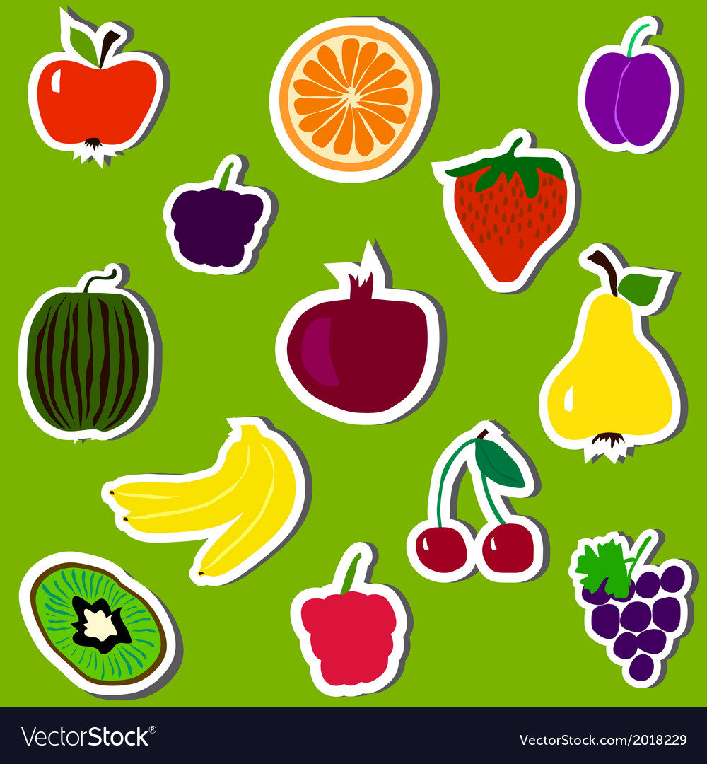 Fruit and berries on green background