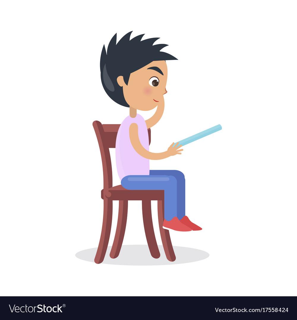 Profile of boy sitting on chair read fairy tale