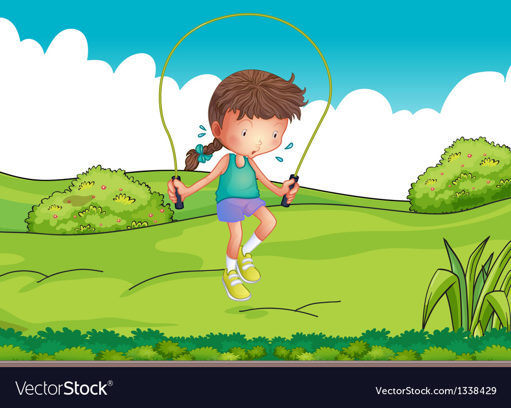 A girl playing jumping rope at the top of the hill