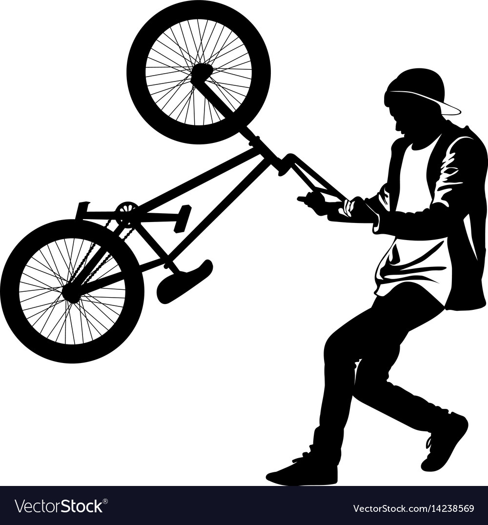 Silhouette of a teenager with a bicycle