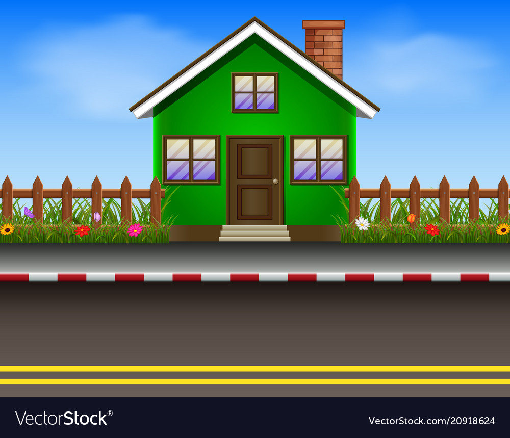 Green house with wooden fence and road