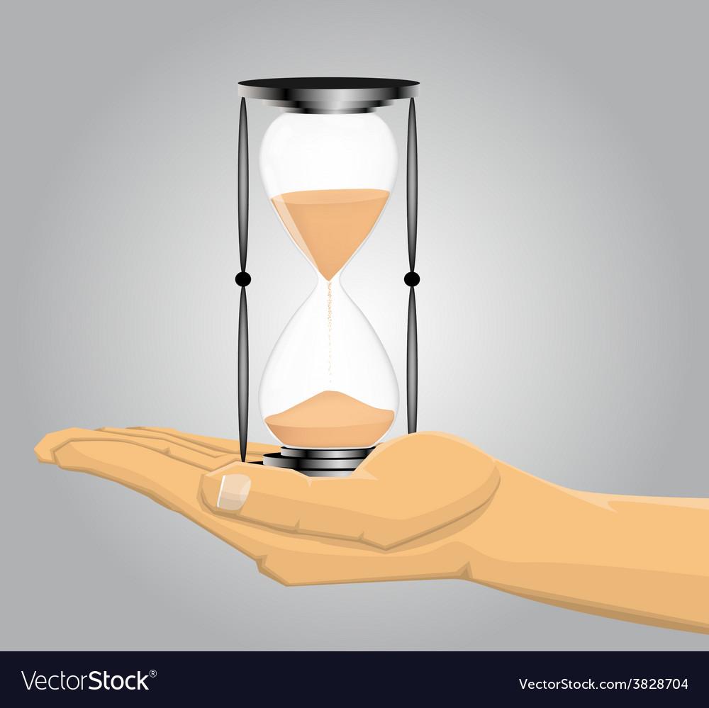Hand holding a sandglass