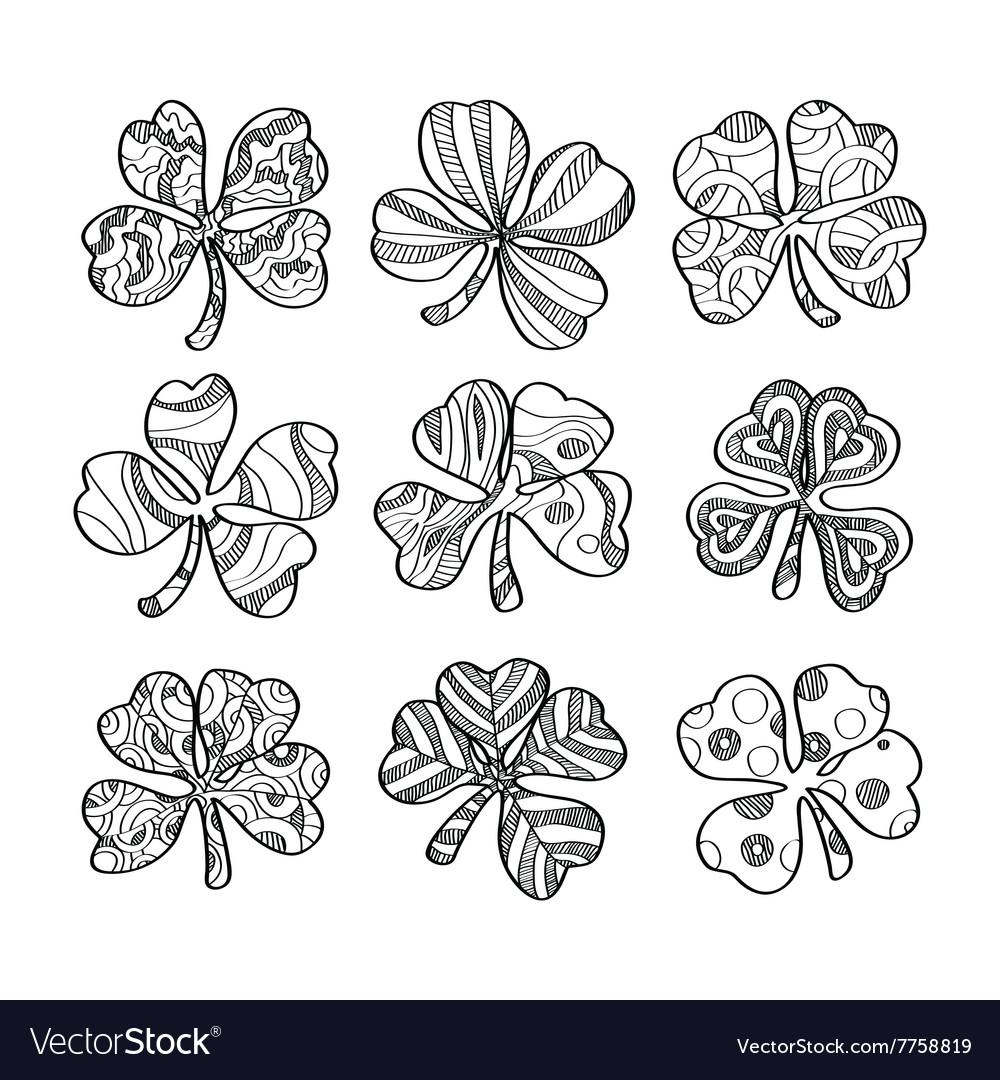 Set of hand drawn monochrome shamrock isolated on