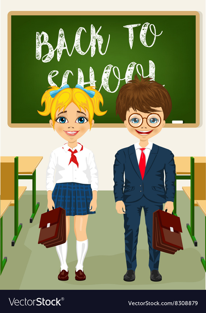 Little boy and girl standing in classroom
