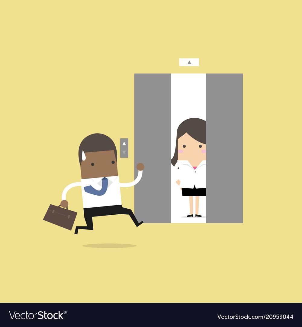 African businessman running to elevator
