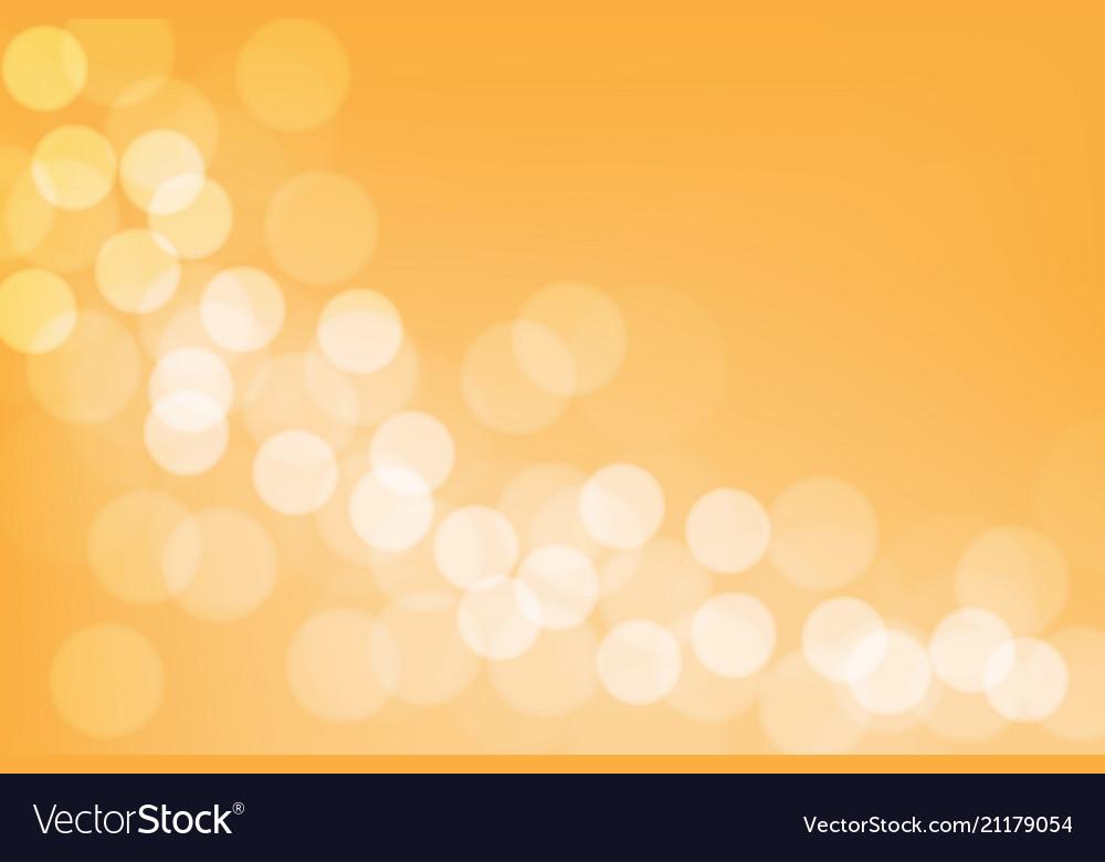Abstract white bokeh blur on orange background