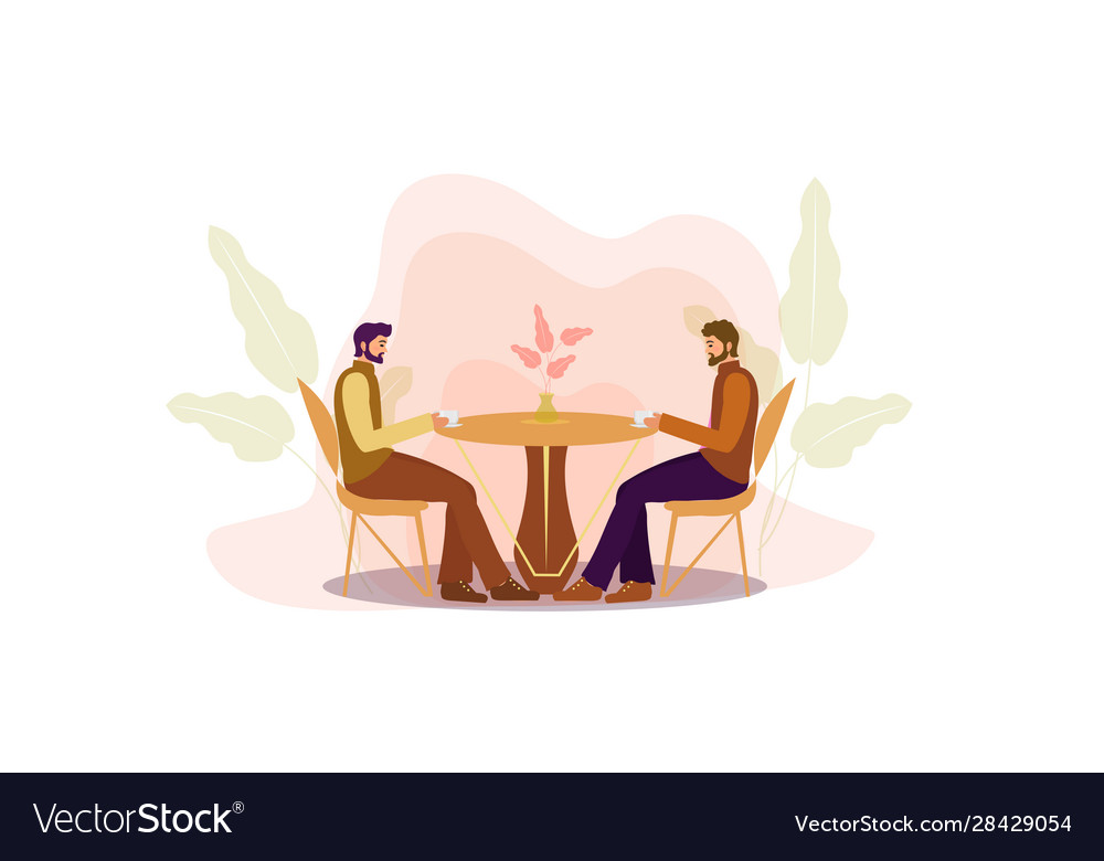 Guys are sitting at a table in a cafe drinking