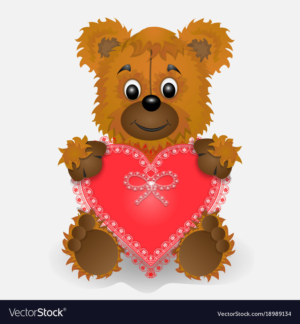 Toy bear holding in the paws of a heart postcard