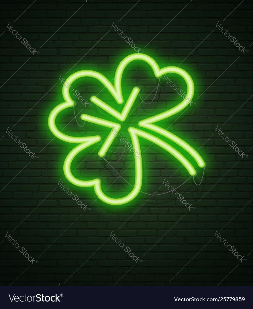 St patricks day neon sign and green brick wall