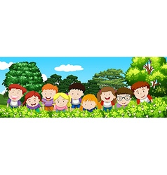 Boys and girls in the garden at daytime vector image vector image