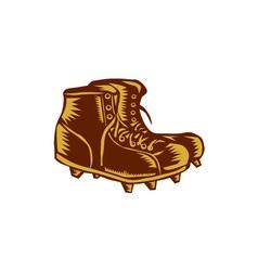 Vintage football boots woodcut vector