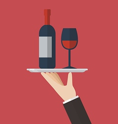 Waiter serving a wine bottle and wine glass vector
