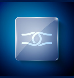 White rope tied in a knot icon isolated on blue vector