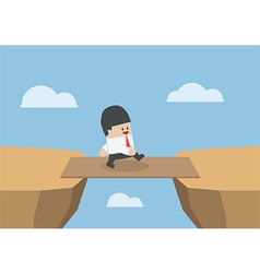 Businessman cross the cliff gap by wooden board vector