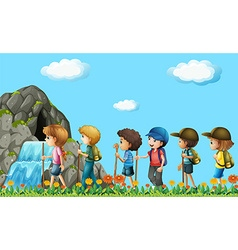 Children hiking in the field vector image