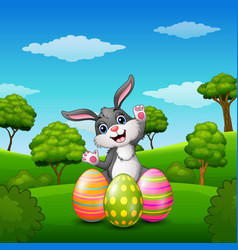 Happy rabbit cartoon with easter eggs in the park vector