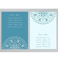 Blue and white flyers with ornate flower pattern vector