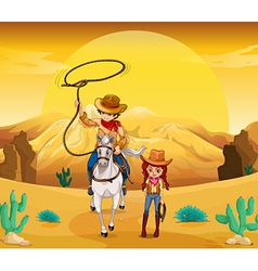 A cowboy and a cowgirl at the desert vector image vector image