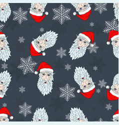 Christmas pattern of the heads of the santa claus vector