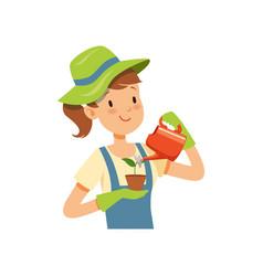 Girl gardener character girl watering a plant vector