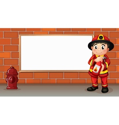 A fireman with a fire extinguisher in front of an vector image