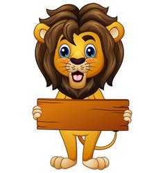Cartoon lion holding an empty wooden board vector