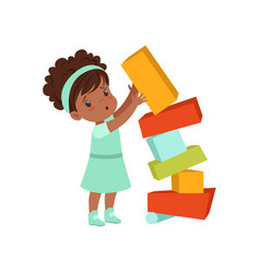 Cute african american girl playing with toy blocks vector