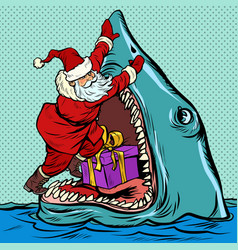 santa claus pushes christmas gift into shark mouth vector image