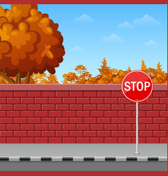 Brick wall with stop sign on the pavement vector