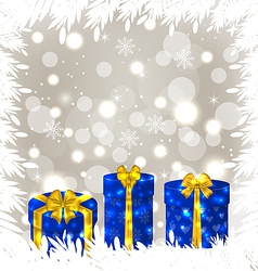 Christmas gift boxes on glowing background vector