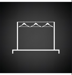 Clothing rail with hangers icon vector image