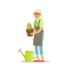 Active senior woman planting cactus in a pot vector