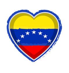 Heart shaped flag of venezuela vector