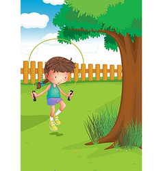A girl playing with a jumping rope at the garden vector image vector image