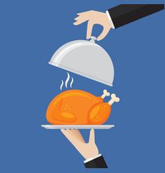 waiter serving a chicken or turkey vector image
