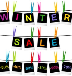 Winter sale concept with photo frames hanging on vector