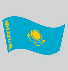 flag of kazakhstan waving on gray background vector image vector image