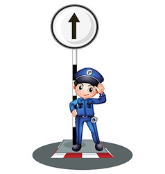 A policeman near the post vector image vector image