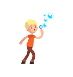 cute boy blowing soap bubbles cartoon vector image