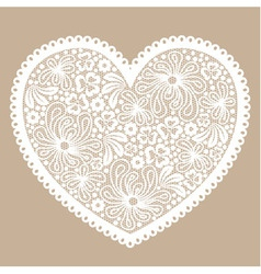 White lacy heart on beige background vector