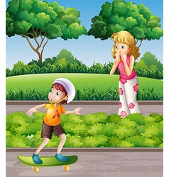 Boy on skateboard and mother in the park vector image