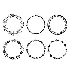 Set black silhouette round tribal frames from vector