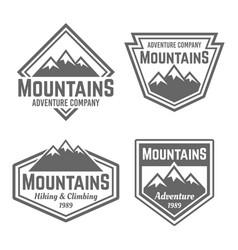 mountains set four vintage badges vector image