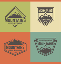 Mountains four colored vintage badges vector